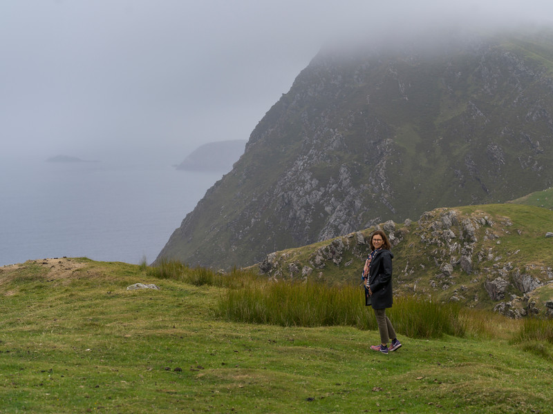 Woman standing by cliff, Achill Island, County Mayo, Ireland