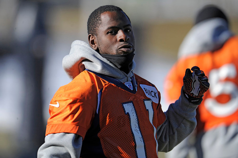 . Denver Broncos wide receiver Trindon Holliday (11) gets ready to put on his helmet during  practice Thursday, January 3, 2013 at Dove Valley.  John Leyba, The Denver Post