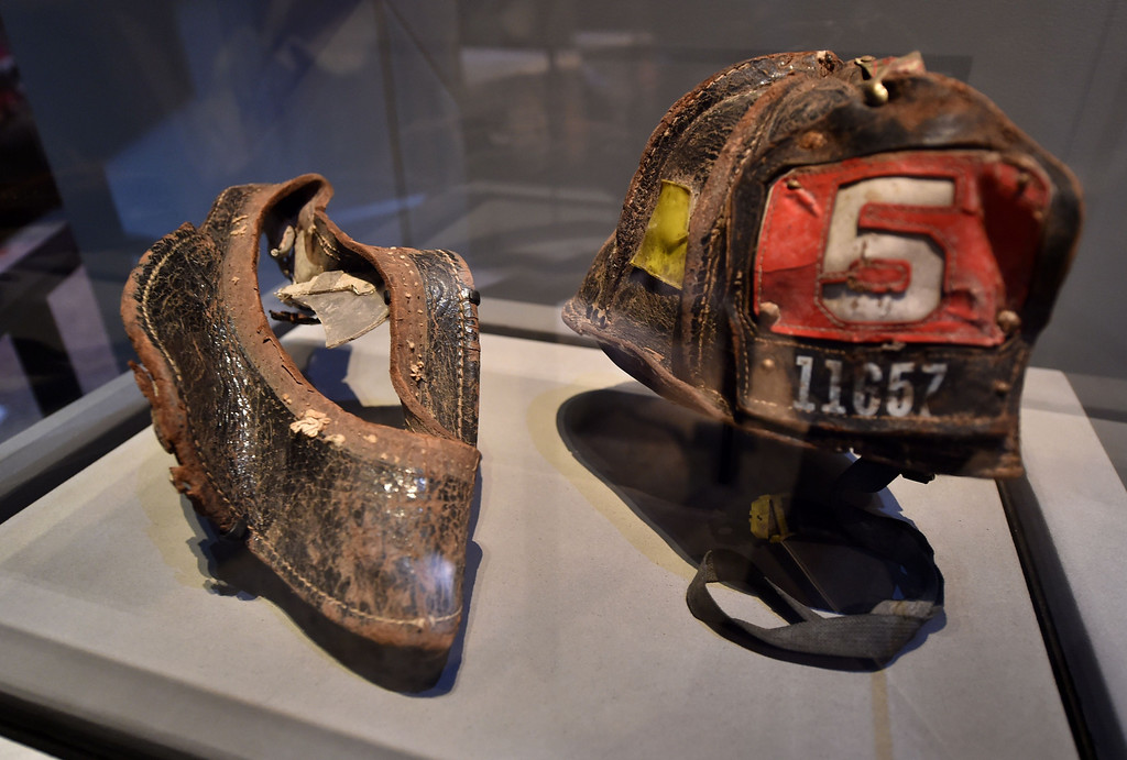 . Helmets worn by New York City Fire Department Firefighter Christian Waugh on September 11, 2001,are seen during a press preview of the National September 11 Memorial Museum at the World Trade Center site May 14, 2014 in New York. AFP PHOTO/Stan HONDA/AFP/Getty Images