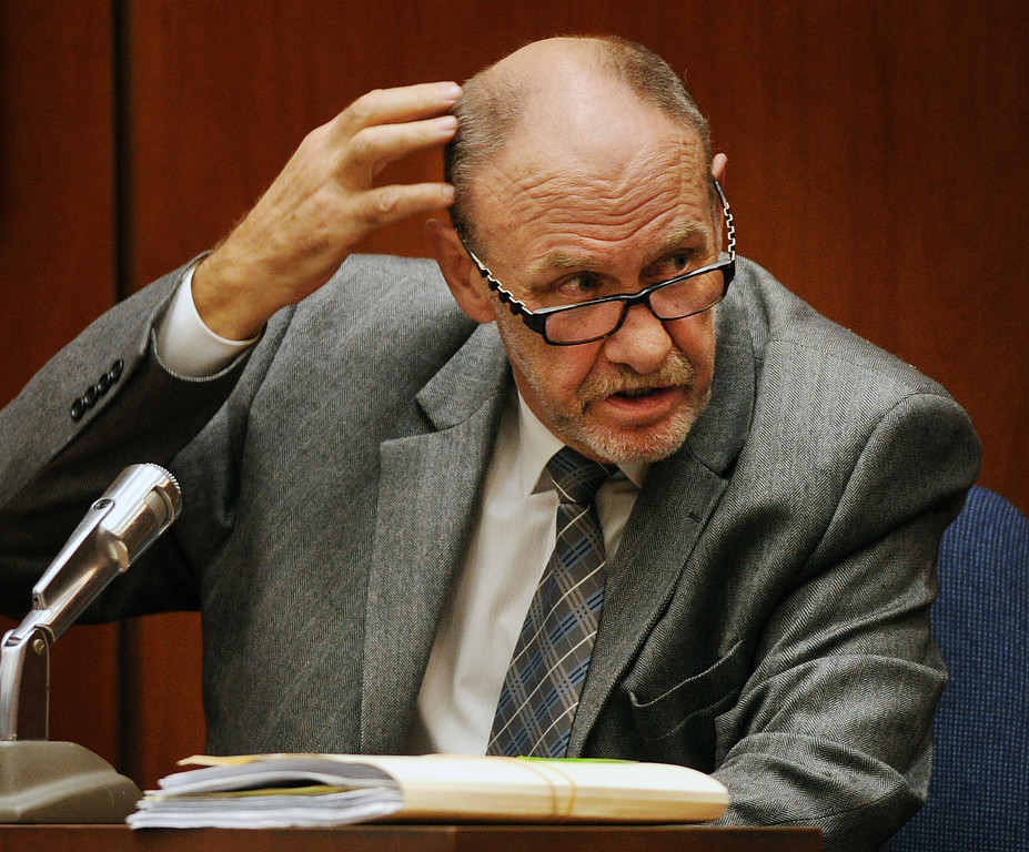 """. Dr. Frank Sheridan, coroner for San Bernardino County pointing to one of the blows to the head that killed John Solus during testamony in the murder trial of Christian Gerhartsreiter, 52,  known as \""""Clark\"""" Rockefeller, second day at trial at Clara Shortridge Fortz Criminal Justice Center in Los Angeles on third day of the trial  Wednesday, March 20, 2013.  Gerhartsreiter is a German immigrant who masqueraded as a member of the Rockefeller family. He is charged with murder of John Sohus, 27, whose bones were unearthed from the backyard of the home in San Marino, California, in 1985.  Sohus\' wife, Linda, has never been found. (SGVN/Photo by Walt Mancini/LANG)"""