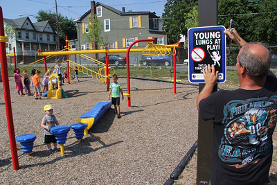 Man Putting Up No Smoking Sign, South Ward Playground, Tamaqua (7-18-2012)
