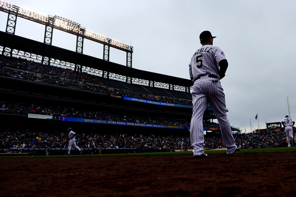 . DENVER, CO - MAY 5: Carlos Gonzalez (5) of the Colorado Rockies takes the field against the Tampa Bay Rays during the Rockies\' 8-3 loss.   (Photo by AAron Ontiveroz/The Denver Post)