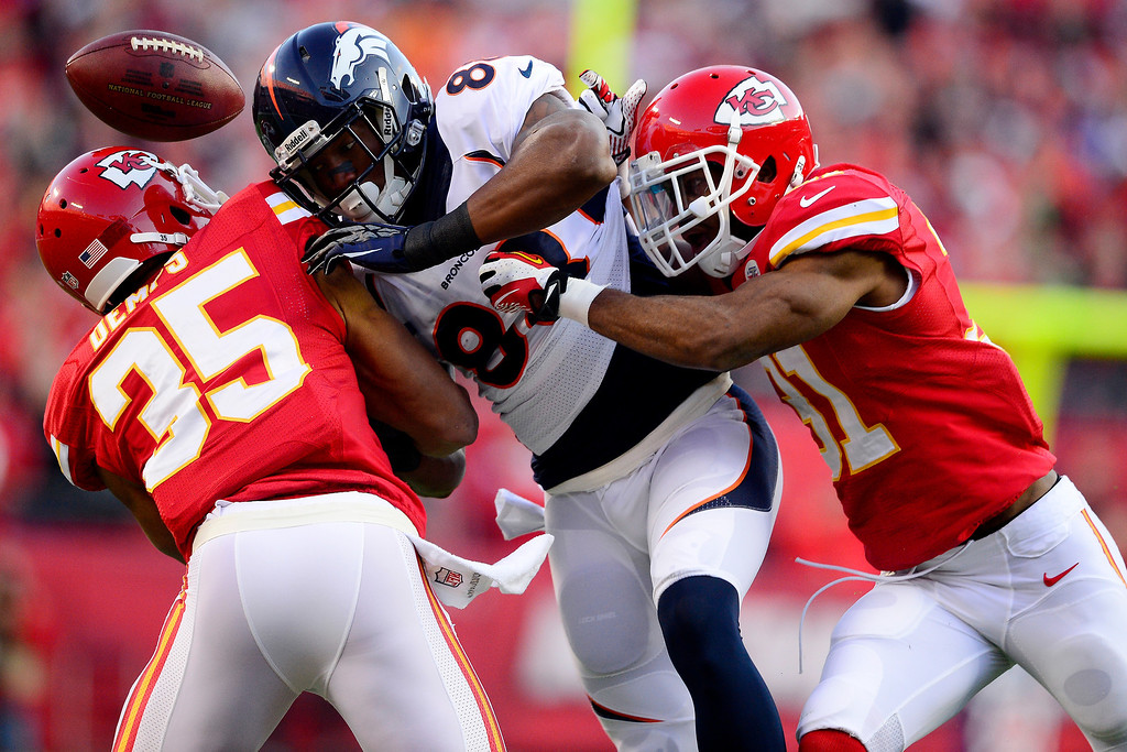 . Marcus Cooper (31) of the Kansas City Chiefs hits Demaryius Thomas (88) of the Denver Broncos knocking the pass loose and into the hands of Quintin Demps (35) of the Kansas City Chiefs during the first half of action at Arrowhead Stadium.   (Photo by AAron Ontiveroz/The Denver Post)