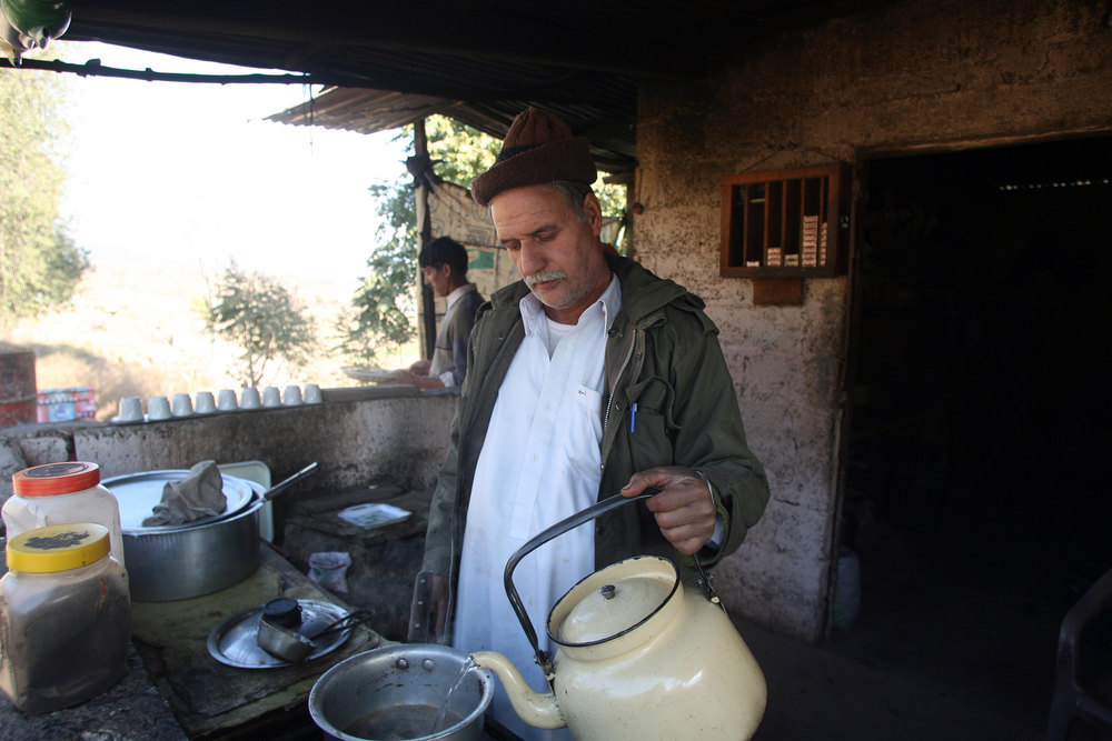 . A Pakistani Kashmiri tea vendor makes a brew for customers at his stall on the way to the town of Titrinot, some 30 kilometers north of Battal sector close of Pakistan-India border, on January 10, 2013. Pakistan on January 10 accused Indian troops of opening fire and killing a Pakistani soldier, the third deadly cross-border incident in days that threatens to escalate tensions in Kashmir. The Pakistan military said the incident happened in the Battal area of the disputed Himalayan region, where a ceasefire has held on heavily militarised Line of Control since 2003, despite violations on both sides. SAJJAD QAYYUM/AFP/Getty Images
