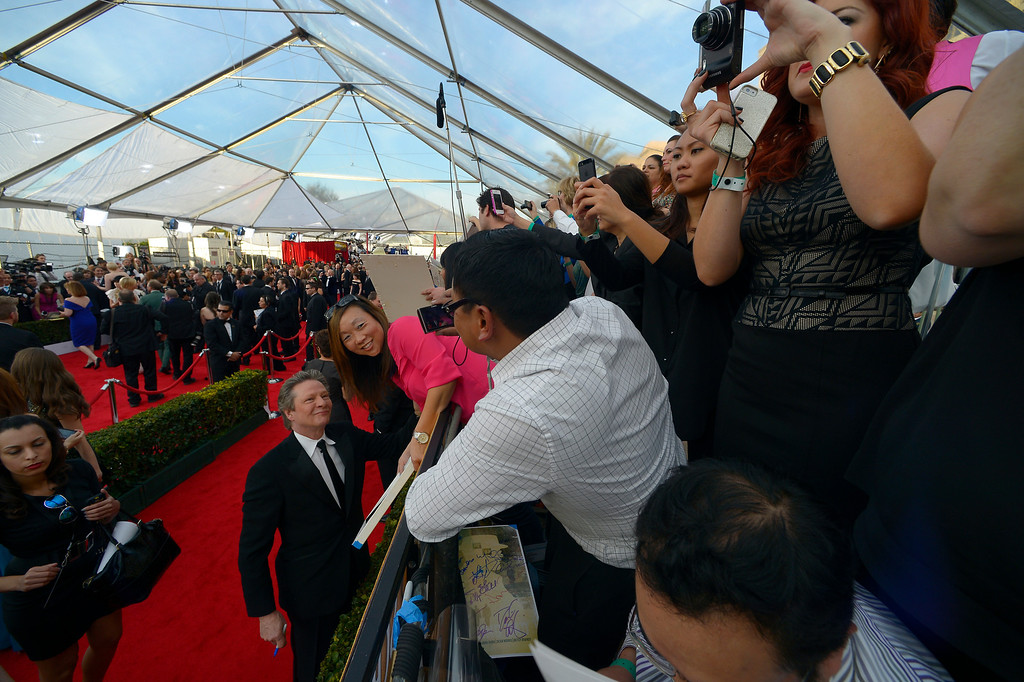 . Chris Cooper poses on the red carpet at the 20th Annual Screen Actors Guild Awards  at the Shrine Auditorium in Los Angeles, California on Saturday January 18, 2014 (Photo by Andy Holzman / Los Angeles Daily News)