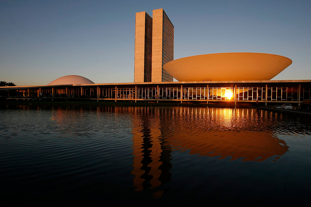 Description of . A view of Brazil's National Congress, designed by Brazilian architect Oscar Niemeyer and inaugurated in 1960, in Brasilia, Brazil. According to a hospital spokeswoman on Wednesday, Dec. 5, 2012, famed Brazilian architect Oscar Niemeyer has died at age 104.  (AP Photo/Eraldo Peres)