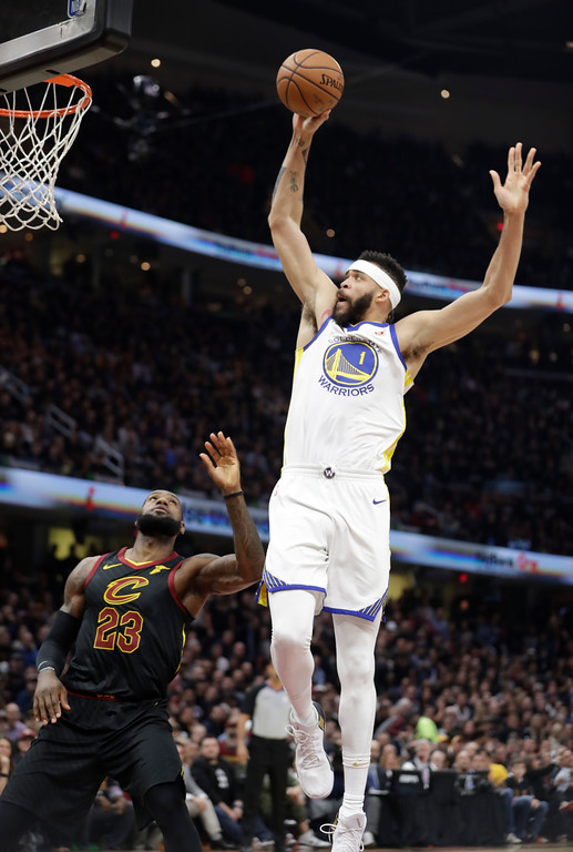 . Golden State Warriors\' JaVale McGee goes up for a shot against Cleveland Cavaliers\' LeBron James in the first half of Game 3 of basketball\'s NBA Finals, Wednesday, June 6, 2018, in Cleveland. (AP Photo/Tony Dejak)