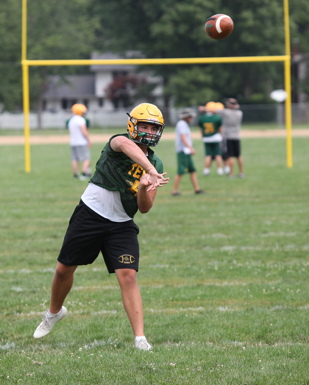 . Randy Meyers - The Morning Journal<br> Amherst quarterback Matt Fairchild throws to a receiver during Amherst\'s first football practice on July 30.