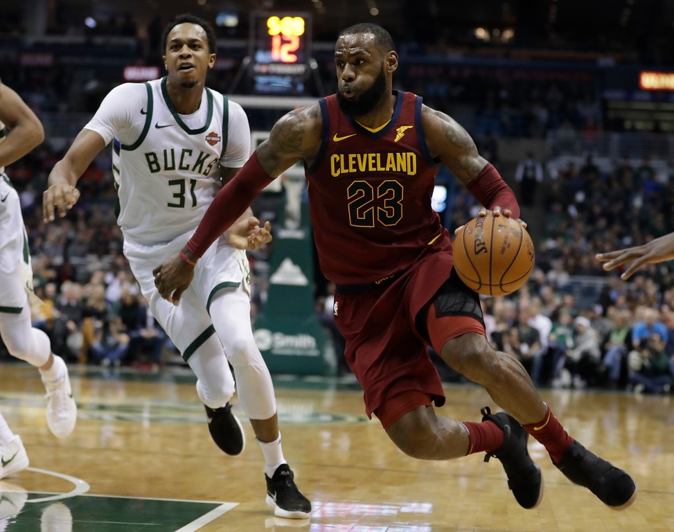 . Cleveland Cavaliers\' LeBron James drives past Milwaukee Bucks\' John Henson during the first half of an NBA basketball game Tuesday, Dec. 19, 2017, in Milwaukee. (AP Photo/Morry Gash)