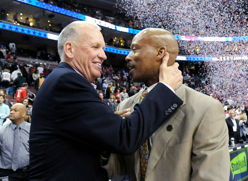 . Philadelphia 76ers head coach Doug Collins, left, talks to Cleveland Cavaliers head coach Byron Scott at the end of an NBA basketball game, Sunday, April 14, 2013, in Philadelphia. The 76ers won their home finale 91-77. (AP Photo/Michael Perez)
