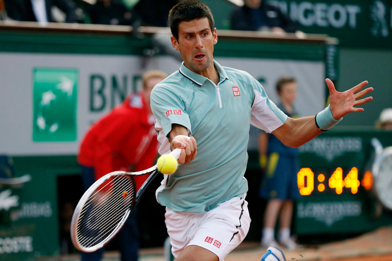 . Serbia\'s Novak Djokovic hits a forehand shot to Belgium\'s David Goffin during a French tennis Open first round match at the Roland Garros stadium in Paris on May 28, 2013. THOMAS COEX/AFP/Getty Images