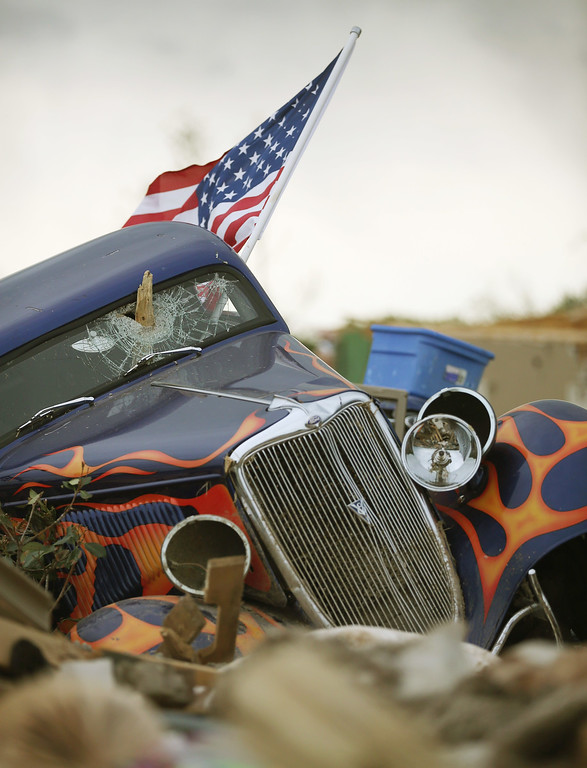 . A 1934 Ford rests at homesite of Dan Wassum, who was killed when a tornado destroyed his home April 29, 2014 in Vilonia, Arkansas. Deadly tornadoes ripped through the region April 27, leaving more than a dozen dead.  (Photo by Mark Wilson/Getty Images)