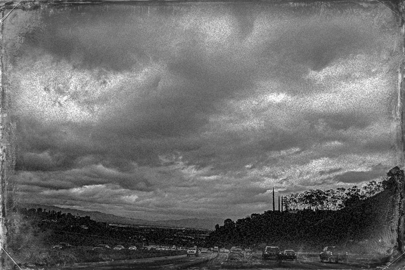March 23 - Clouds, a freeway and a couple of trees before a rainstorm.jpg