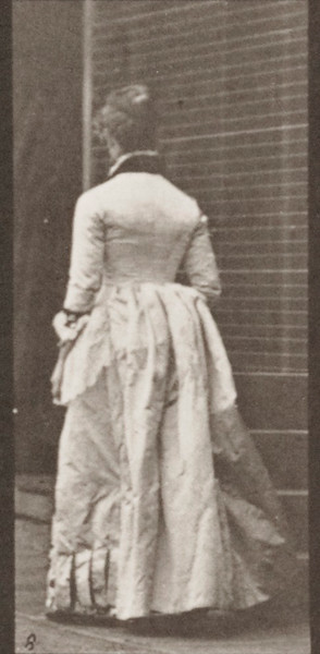 Woman descending stairs and turning