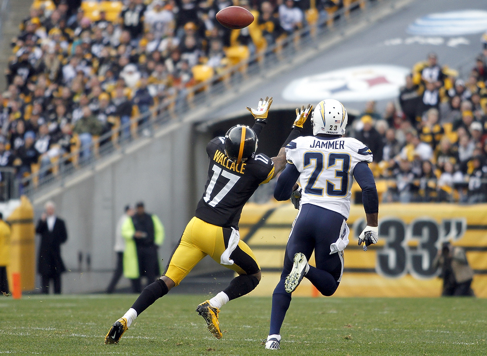 Description of . Mike Wallace #17 of the Pittsburgh Steelers can't make a catch against Quentin Jammer #23 of the San Diego Chargers during the game on December 9, 2012 at Heinz Field in Pittsburgh, Pennsylvania.  (Photo by Justin K. Aller/Getty Images)