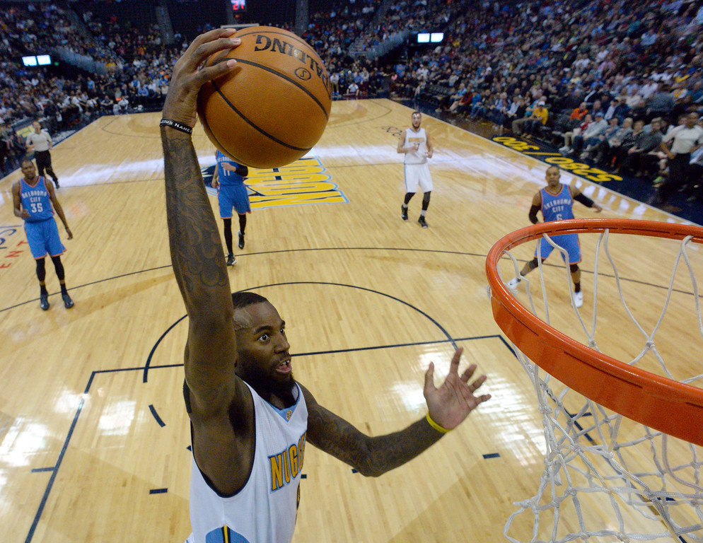 . Denver Nuggets guard JaKarr Sampson (9) goes up for a dunk agains the Oklahoma City Thunder  April 5, 2016 at Pepsi Center. (Photo By John Leyba/The Denver Post)