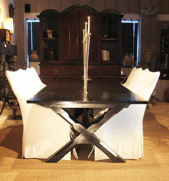 """X-Leg"" dining table with pewter candle inserts. These candles are inserted through a pewter piece fixed into the table top, making them removable. Design by Maison e Maison."
