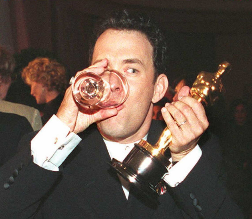 ". US actor Tom Hanks holds up his Oscar as he drinks a glass of water while attending the Governor\'s Ball after the 67th annual Academy Awards in Los Angeles 27 March. Hanks won as best actor for his role in the film ""Forrest Gump\"" which also won five other awards, including best film and best director.  Vince Bucci/AFP/Getty Images"