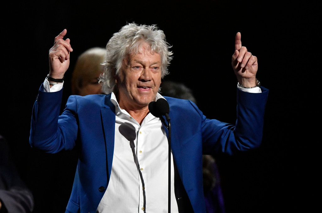 . John Lodge, bassist for the Moody Blues, speaks during the Rock and Roll Hall of Fame induction ceremony, Saturday, April 14, 2018, in Cleveland. (AP Photo/David Richard)