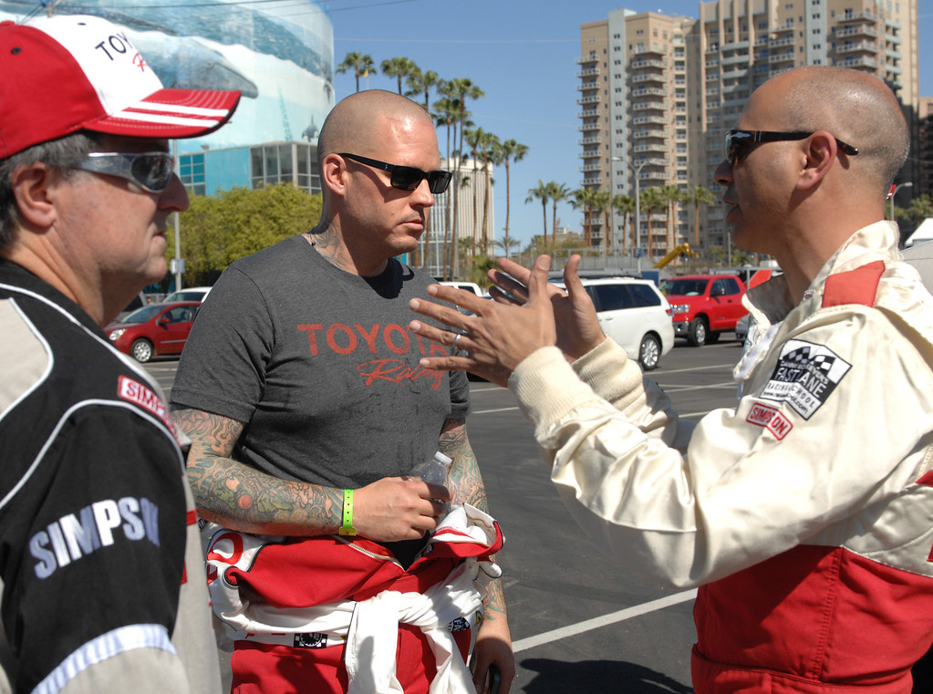 . 4/9/13 - Carter Lay  center, and Jochen Tartak, right, talk about the course during media day for the 39th Annual Toyota Grand Prix of Long Beach. The celebrity/pro races spent the day practicing on the track, joking with their racing partners and giving interviews. Photo by Brittany Murray / Staff Photographer