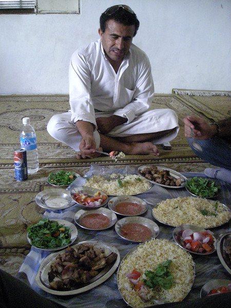 having a meal with camel meat in the Hadramout