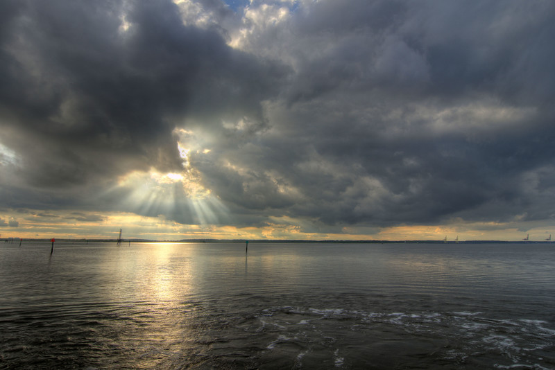 The sun breaks through cloudy skies during a ride on the North Carolina Ferry to Southport from Kure Beach, NC on Friday, June 5, 2015. Copyright 2015 Jason Barnette