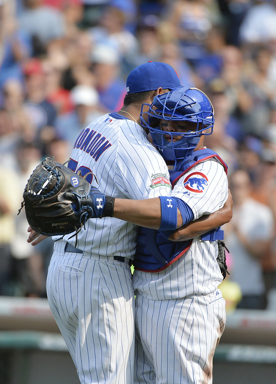 . Catcher Welington Castillo #5 of the Chicago Cubs hugs relief pitcher Hector Rondon #56 after their game against the Colorado Rockies at Wrigley Field on July 31, 2014 in Chicago, Illinois. The Cubs defeated the Rockies 3-1.  (Photo by Brian Kersey/Getty Images)