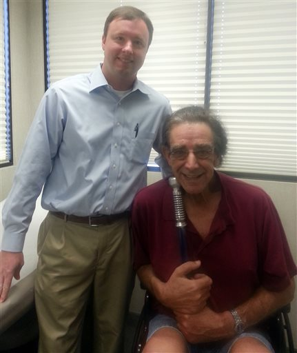 """. This undated photo provided by Angie Mayhew shows Dr. Jeffrey McGowen, left, and actor Peter Mayhew. Mayhew, who is best known for his portrayal of Chewbacca in the \""""Star Wars\"""" films, has had double knee-replacement surgery at a Texas hospital. (AP Photo/Courtesy of Angie Mayhew)"""