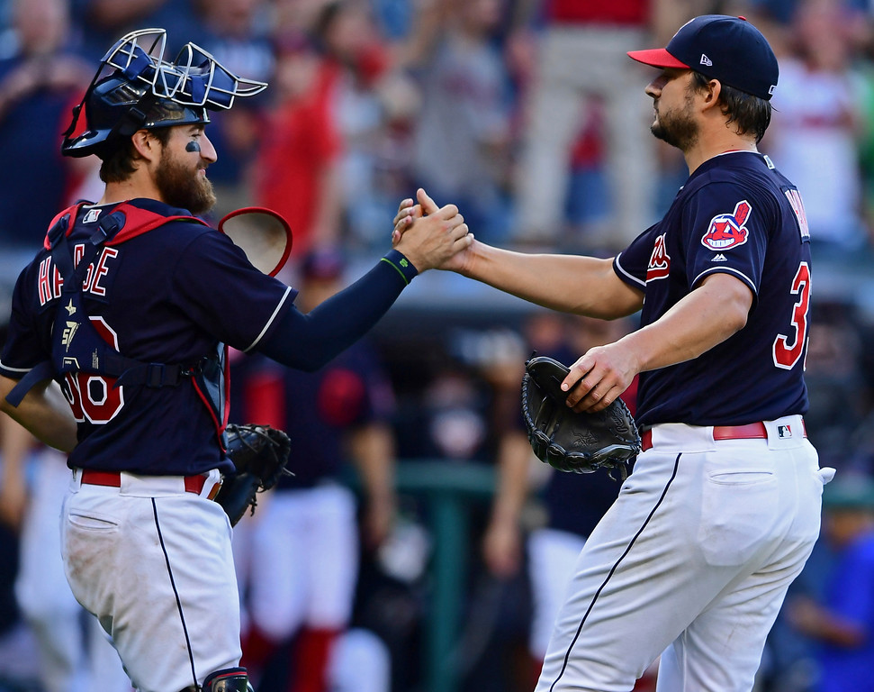 . Cleveland Indians relief pitcher Brad Hand, right, is congratulated by catcher Eric Haase after defeating the Detroit Tigers 15-0 in a baseball game, Saturday, Sept.15, 2018, in Cleveland. (AP Photo/David Dermer)