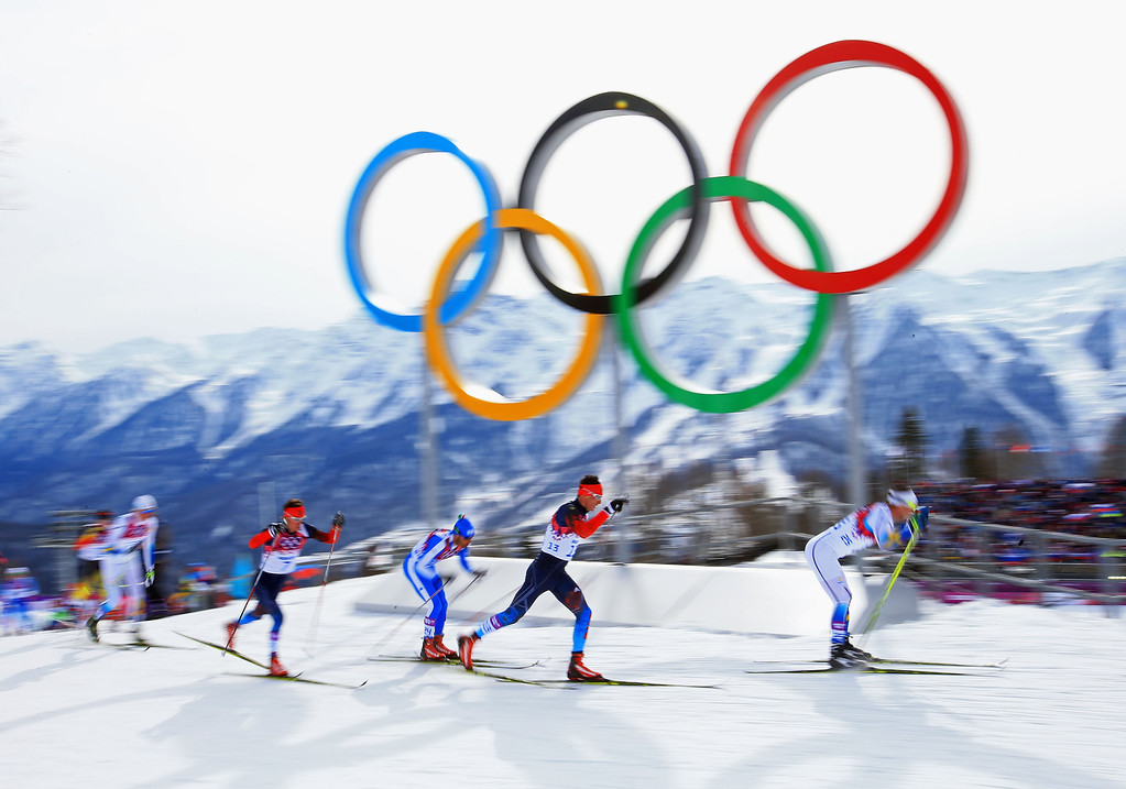 . SOCHI, RUSSIA - FEBRUARY 09:  Evgeniy Belov (2R) of Russia and Anders Soedergren (R) of Sweden lead the pack in the Men\'s Skiathlon 15 km Classic + 15 km Free during day two of the Sochi 2014 Winter Olympics at Laura Cross-country Ski & Biathlon Center on February 9, 2014 in Sochi, Russia.  (Photo by Richard Heathcote/Getty Images)