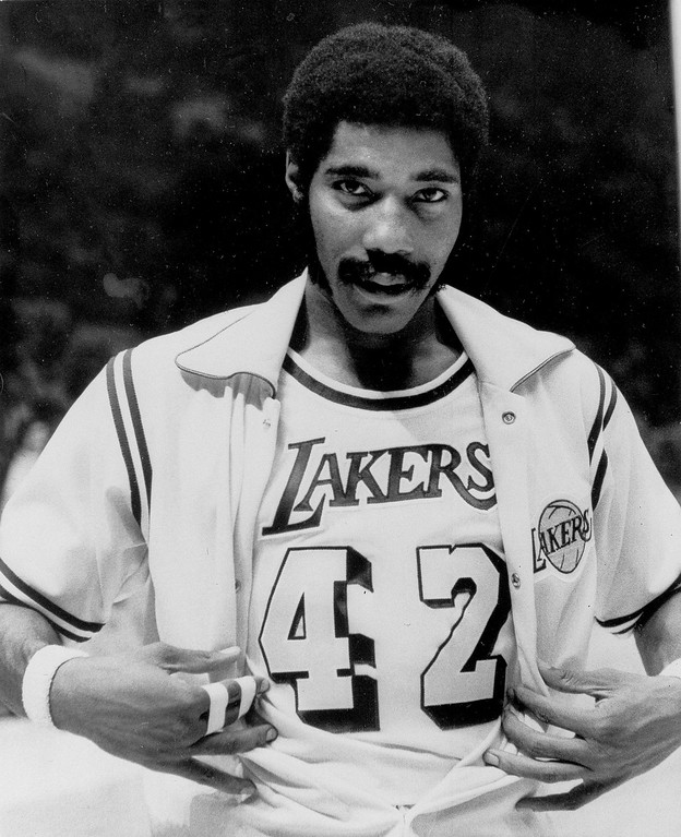 """. FILE - In this Nov. 2, 1973, file photo, Connie Hawkins shows off his new Los Angeles Lakers uniform before start of game against the New York Knicks in Inglewood, Calif. Basketball great Connie Hawkins has died at 75. The Hall of Famer\'s death was announced in a statement Saturday, Oct. 7, 2017,  by the Phoenix Suns, the team with which he spent his most productive NBA seasons. The Suns told The Associated Press they confirmed the death with his family. The 6-foot-8 Hawkins was a dazzling playground legend in New York City who rose to basketball\'s heights. The Suns lauded his \""""unique combination of size, grace and athleticism.\"""" (AP Photo/David Smith)"""