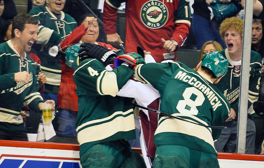 . Wild defenseman Clayton Stoner, left, and center Cody McCormick gang up on Avalanche center Brad Malone in the first period.  (Pioneer Press: Ben Garvin)