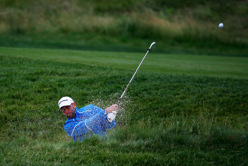 . Josh Teater of the United States hits a shot from a bunker on the 15th hole during a continuation of Round One of the 113th U.S. Open at Merion Golf Club on June 14, 2013 in Ardmore, Pennsylvania.  (Photo by Rob Carr/Getty Images)