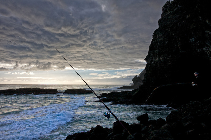 Rock fishing at Karekare beach