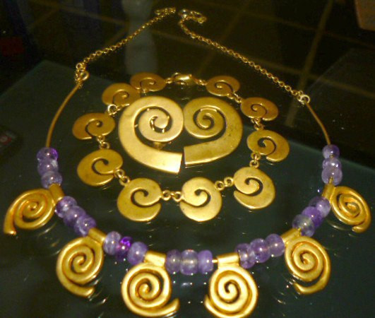 Amethyst & gold-toned Spiral Jewels: 1 - Spiral & Amethyst Necklace (Larger/6 spirals) = $80 2 - Spiral bracelet (Smaller) = $60 3 - Spiral slide = $35 (not pictured) 4 - Spiral clip-on earrings = $35 (a popular Costa Rican Antiquity design)  REDUCED!! ALL 4 pieces: $150   @@@@@@@@@@@@@   MORE SPIRAL THINGS: Purple Spiral Writing PEN, thick, barely used! Want to impress??? This definetly has the COOL factor!     REDUCED:  $15   TAKE IT ALL for just $160!!!