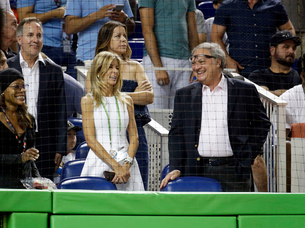 . Miami Marlins owner Jeffrey Loria, right, smiles, during the MLB baseball All-Star Game, Tuesday, July 11, 2017, in Miami. (AP Photo/Lynne Sladky)