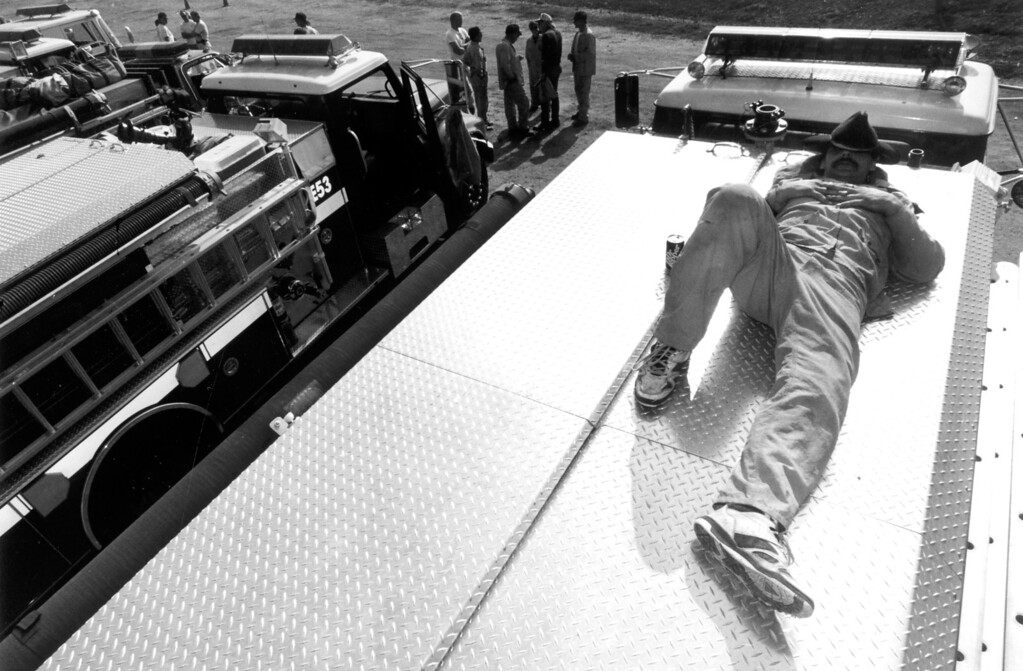 . Firefighter Louis Edwards rests at the Malibu Civic Center on November 6, 1993.   Los Angeles Daily News file photo