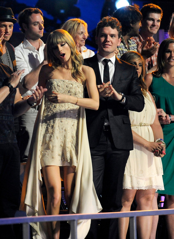 . Taylor Swift, left, and Austin Swift dance in the audience at the 2013 CMT Music Awards at Bridgestone Arena on Wednesday, June 5, 2013, in Nashville, Tenn. (Photo by Donn Jones/Invision/AP)
