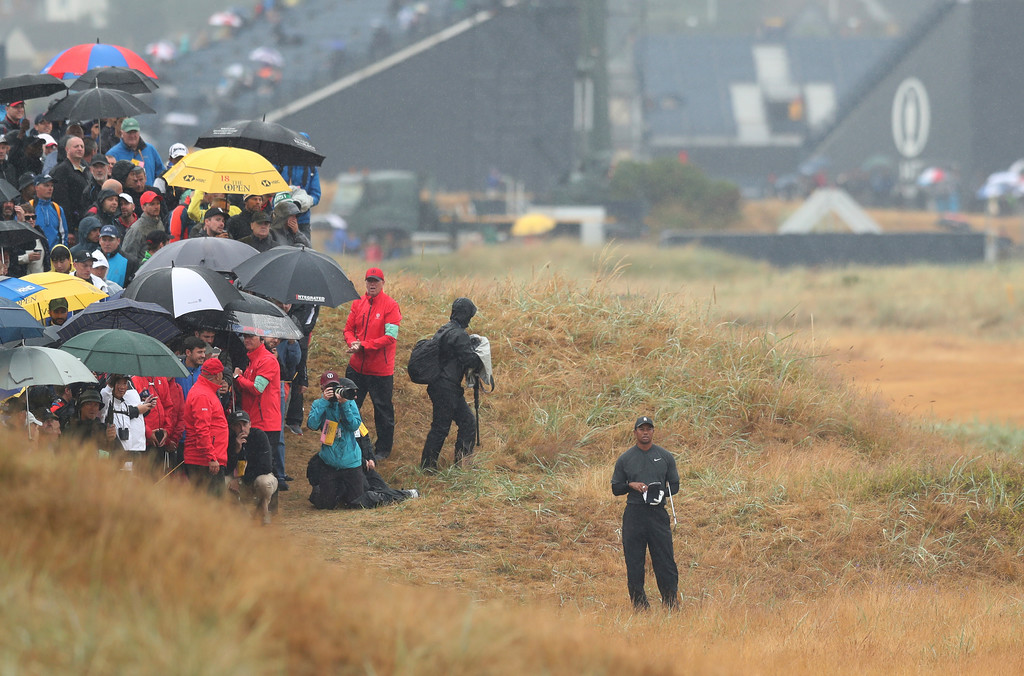 . Tiger Woods of the US stands in the rough on the 2nd hole during the second round of the British Open Golf Championship in Carnoustie, Scotland, Friday July 20, 2018. (AP Photo/Jon Super)