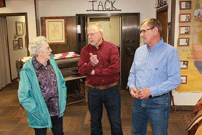Volunteer Alberta Reynolds chats with Don and Perry