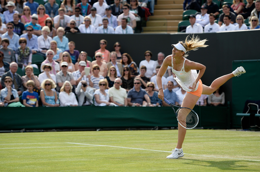 . Maria Sharapova of Russia serves during her Ladies\' Singles second round match against Michelle Larcher de Brito of Portugal on day three of the Wimbledon Lawn Tennis Championships at the All England Lawn Tennis and Croquet Club on June 26, 2013 in London, England.  (Photo by Dennis Grombkowski/Getty Images)