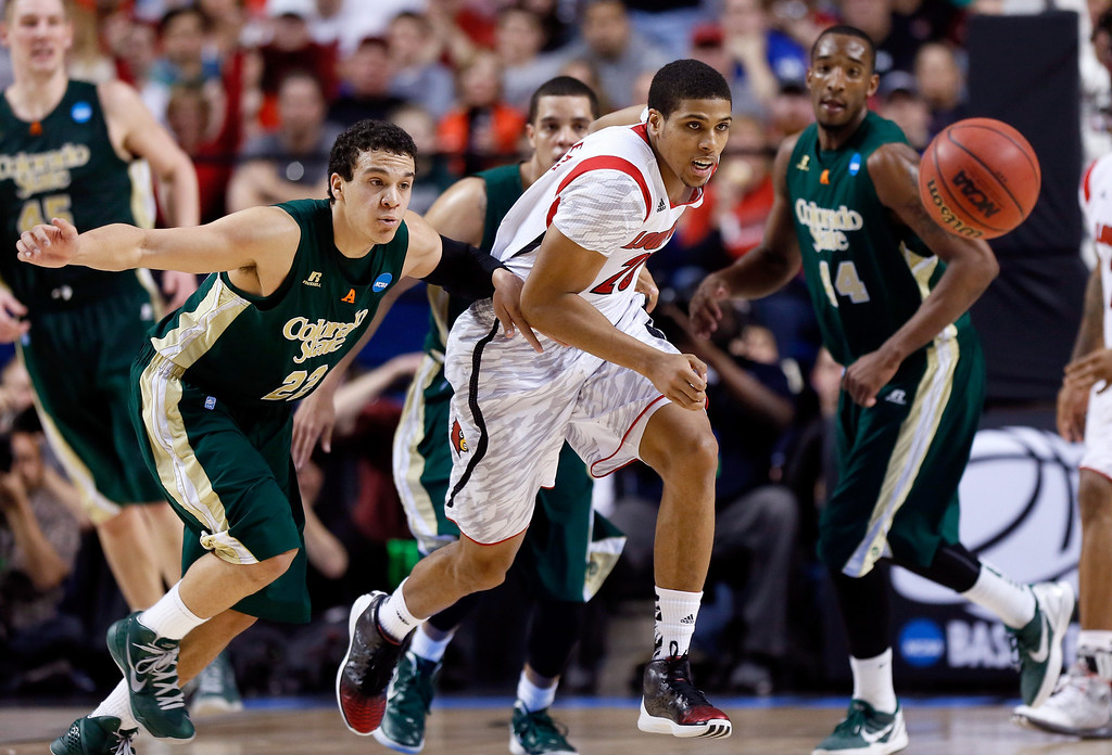 . LEXINGTON, KY - MARCH 23: Dorian Green #22 of the Colorado State Rams and Wayne Blackshear #20 of the Louisville Cardinals go for a loose ball in the second half during the third round of the 2013 NCAA Men\'s Basketball Tournament at Rupp Arena on March 23, 2013 in Lexington, Kentucky.  (Photo by Kevin C. Cox/Getty Images)