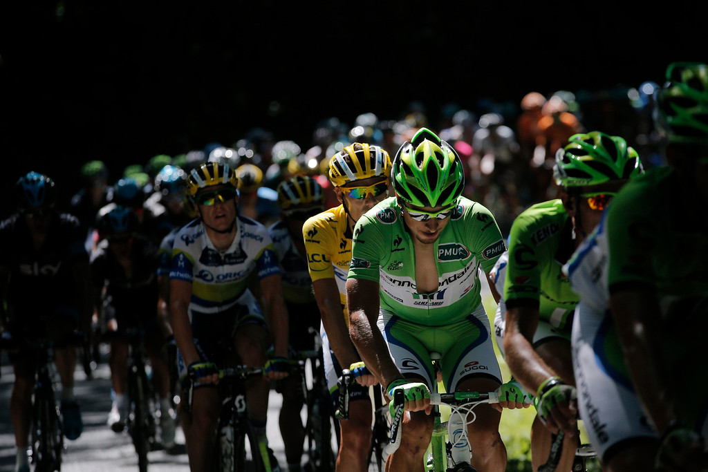 . Peter Sagan of Slovakia, wearing the best sprinter\'s green jersey, and Daryl Impey of South Africa, wearing the overall leader\'s yellow jersey, ride in the pack during the seventh stage of the Tour de France cycling race over 205.5 kilometers (128.5 miles) with start in Montpellier and finish in Albi, southern France, Friday July 5, 2013. (AP Photo/Christophe Ena)