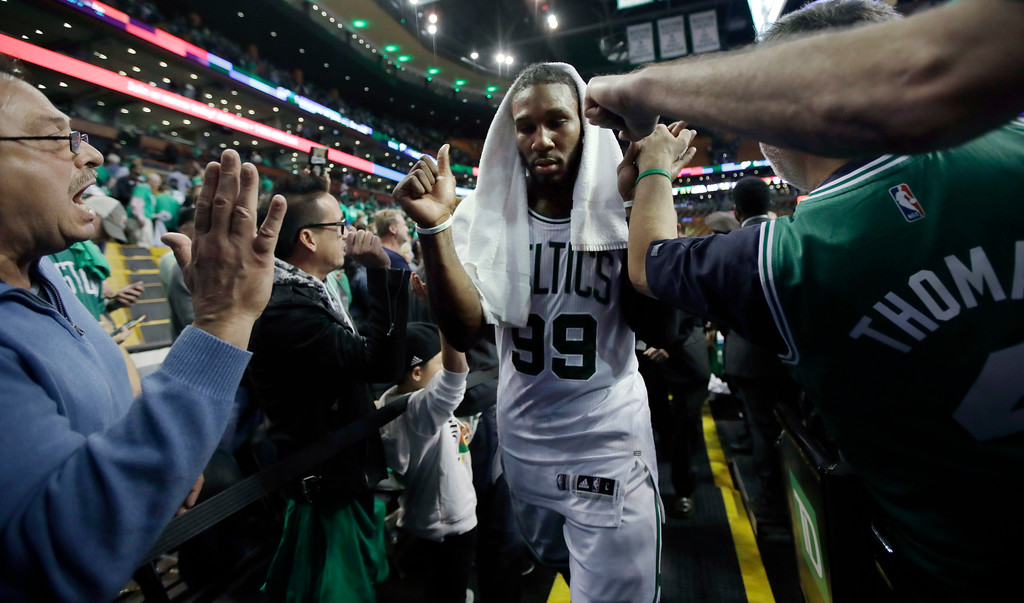 . Fans congratulate Boston Celtics forward Jae Crowder after Game 7 of a second-round NBA basketball playoff series, Monday, May 15, 2017, in Boston. The Celtics won 115-105 to advance to the Eastern Conference championship series. (AP Photo/Charles Krupa)