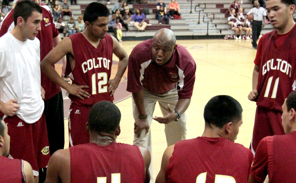 . Colton High School boys basketball coach Ty Gordon, center, speaks with his team during a game against Fontana High School on Thursday, January 31, 2013. Gordon has been named coach of the year to The Sun\'s All-Valley Boys Basketball First Team. Micah Escamilla/For The Sun.