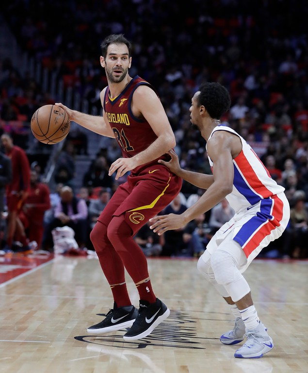 . Cleveland Cavaliers guard Jose Calderon controls the ball next to Detroit Pistons guard Ish Smith during the second half of an NBA basketball game, Monday, Nov. 20, 2017, in Detroit. (AP Photo/Carlos Osorio)