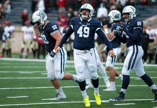 11/23/19 Wesley Bunnell | StaffrrYale rallied late in The Game against Harvard on Saturday afternoon at the Yale Bowl for a 50-43 victory in double over time. K Sam Tuckerman (49) celebrates after tying the game with seconds left on the clock in the 4th quarter.