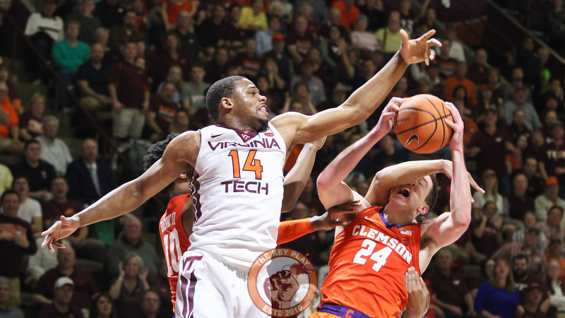 P.J. Horne attempts to block Clemson's David Skara as he is fouled in the face from behind. (Mark Umansky/TheKeyPlay.com)