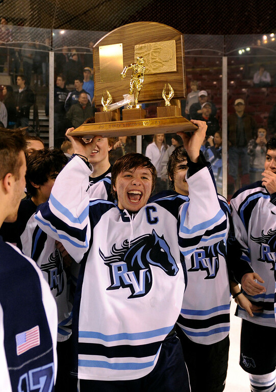 . DENVER, CO. - FEBRUARY 28: Mustangs forward Charles Joly (18) took his turn with the trophy Friday night. Ralston Valley High School beat Monarch 5-1 Friday night, March 1, 2013 to win the Colorado hockey championship at Magness Arena in Denver. (Photo By Karl Gehring/The Denver Post)