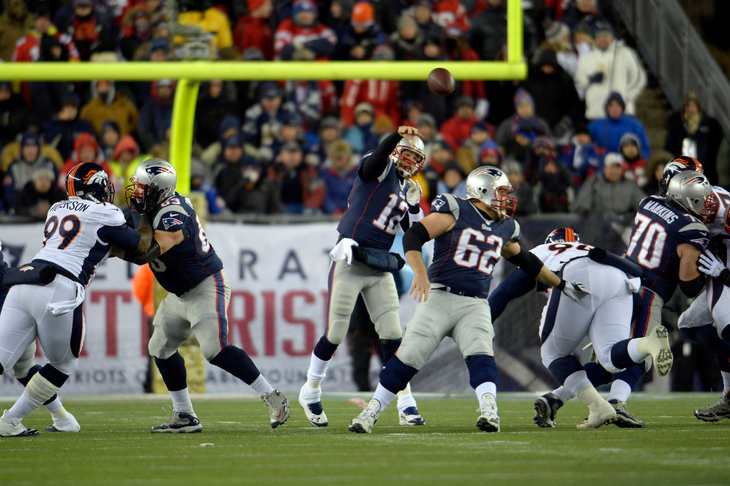 . New England Patriots quarterback Tom Brady (12) throws a pass down field on the Denver Broncos defense during the first quarter November 24, 2013 at Gillette Stadium. (Photo by Joe Amon/The Denver Post)